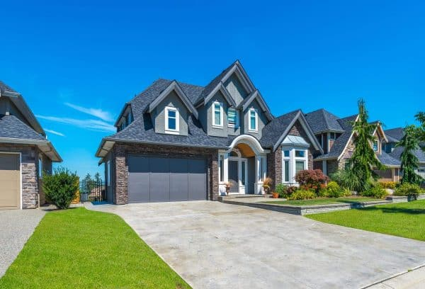 Beautiful Home with Grey Garage and Roofing Shingles
